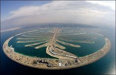 Palm Jumeirah, a man made island for tourism, commercial & residential uses off the coast of Dubai. Dubai Islands, Palm Island Dubai, Palmeninsel Dubai, Palm Jumeirah, Vacation Destinations, Dream Vacations, Where To Go, Beautiful World, Wonders Of The World