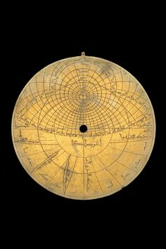 Date:14th century. Place:North Africa. Material:Brass. Astrolabe Catalogue Inventory no.53556. The back contains 5 scales of the following types: Altitude; Zodiacal signs; Calendar; Unequal hours; Shadow square. The zodiac on the rete is labelled: الحمل , الثور , الجوزا , السرطان , الاسد , السنبله , الميزان , العقرب , القوس , الجدي , الدلو , الحوت .
