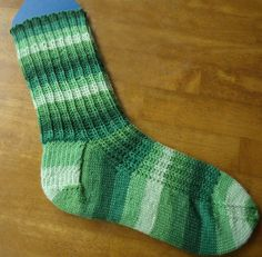 This free knit sock pattern is perfect for knitting on the go.  Turn those spare seconds into complete stitches with this easy and fun sock knitting pattern.