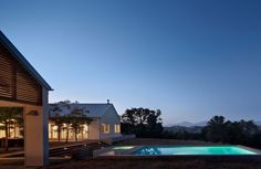 white modern house exterior gravel driveway metal roof mountain home exterior pool evening cocoozy nick noyes architecture HEALDSBURG GABLE ROOF Modern ARCHITECT TOUR Contemporary Bedroom Decor, Rustic Contemporary, Contemporary Interior, Contemporary Office, Contemporary Apartment, Contemporary Wallpaper, Contemporary Chandelier, Contemporary Landscape, Landscape Design