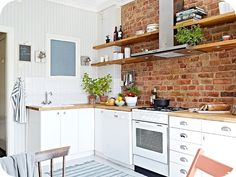 love the butcher block counters and the brick wall Brick Tiles Kitchen, Exposed Brick Kitchen, Kitchen Family Rooms, Studio Kitchen, Hamptons House, Kitchen Colors, Country Kitchen, Home And Living, Sweet Home