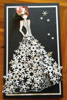 What a beautiful snowflake dress for a winter bride! Snowflake punches make up the flowing skirt of this dress on this handmade wedding card.