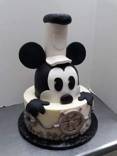 Vintage Mickey Mouse Cake. Grooms Cake. Brithday Cake. Mickey Mouse Cake. Disney Cake. Disney Wedding Cake. Wedding Planning. Grooms Cake. Carved Cake. Fondant Cake.