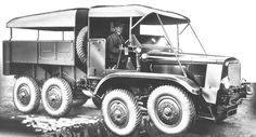 A Guy 8-wheel driven vehicle crossing a trench.