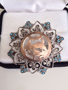 Arts & Crafts Era Antique Seed Turquoise and Marcasite Hearts Accents Central Dome Filagree Cut Out Deer Sterling Silver Pin Brooch Pendant