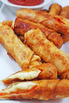 Bacon, Butter, Cheese & Garlic: Pizza Egg Rolls...this recipe is embarrassingly easy!