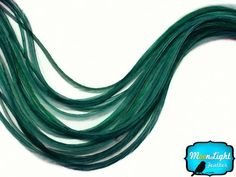 Moonlight Feather, Hair Extension Feathers - Solid Peacock Green - 11.5+ Inches Long, 6 Pieces by Moonlight Feather. $9.89. These are natural feathers so each one will be unique. Can be washed, dried, curled and straightened.. 100% Grown and packed in USA!. 6 Feather Per Pack; 11+ Inches long. We ship same day M-F on order received before 1pm PST. No shipping on weekends. Let us know if you need rush delivery.. Solid color with no pattern.. This listing is for 6 individua...