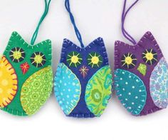 Colorful owl Christmas ornaments, handmade from felt and cotton prints with hand embroidered details. Each owl is 8cm high and has a cotton loop for hanging. The owl ornaments come in a set of 3, in v