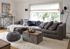 Image result for blue charcoal couch with curtains and wood floors