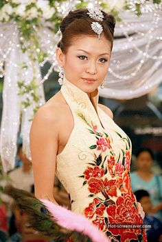 """Oriental Cheongsam is the Chinese traditional costume for women and origin from China's Manchu Nationality. Cheongsam is also known as """"Qipao"""". It became popular when the modern version which was more slender, fitting body with high cut was. Chinese Wedding Dress Traditional, Chinese Traditional Costume, Vietnamese Traditional Dress, Traditional Dresses, Traditional Weddings, Bridal Dresses, Wedding Gowns, Bridesmaid Dresses, Wedding Hair"""