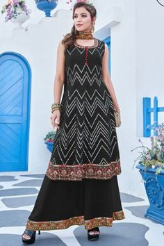 Sway away everyone with your simplicity as you wear this black georgette sharara suit which will instantly catch your fancy. This u neck and sleeveless outfit beautified with thread and faux mirror work. Completed with georgette palazzo pant in dark black color with dark black net dupatta. Palazzo pant and dupatta also elaborated using thread and faux mirror lace. #shararasuits #malaysia #Indianwear #weddingwear #andaazfashion Sharara Suit, Churidar, Anarkali, Salwar Kameez, Lehenga, Kurti, Indian Attire, Indian Wear, Curvy Fashion