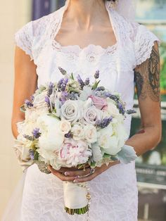 Dusty purple wedding bouquet with roses, peonies, dusty miller and fresh lavender