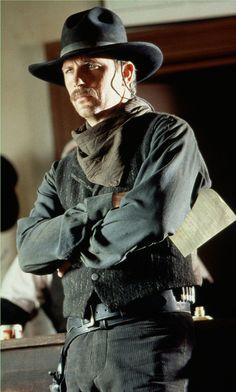 WYATT EARP (1994) - Kevin Costner as 'Marshal Wyatt Earp' contemplates a showdown with the Clanton Gang - Produced by Kevin Costner, Jim Wilson & Lawrence Kasdan - Directed by Lawrence Kasdan - Warner Bros. - Publicity Still.