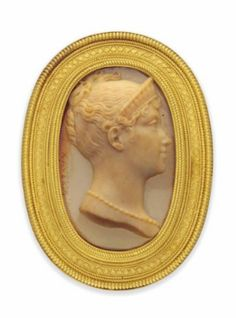 From the Collection of the Late Mrs T.S. Eliot. A 19TH CENTURY GOLD AND HARDSTONE CAMEO BROOCH, BY CASTELLANI. The early 19th century oval agate panel carved to depict the bust length profile of a lady wearing a diadem and necklace, possibly Empress Marie Louise, second wife of Napoleon I, to an Archaeological Revival frame with corded border and wirework detailing, circa 1870, with maker's mark for Castellani, cameo signed Xaveria.