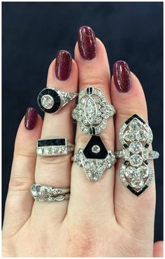 A hand full of Art Deco onyx and diamond rings from DK Bressler. The one all the way on the right is by Marcus and Co.