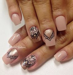 A beautiful nude nail art design with black polish and gold dust on top. Paint on intricate designs of laces on top and cap them off with sophisticated gold dust. The design even alternates from a cuticle polish to a French tip style every other nail.