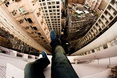 "Lovely view but don't look down: 25 of the most extreme ""rooftopping"" photos ever"