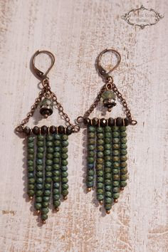 Boho Chic Earrings, Rustic Earrings, Bohemian Earrings, Khaki Statement Earrings, Chandelier Earrings Features olive green - khaki and brown glass beads , antique rhinestones and antique bronze wire . With copper lever back ear hooks. These are a statement earrings sophisticated
