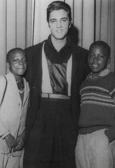 """.../""""@Bri Allard  Elvis Presley is pictured with renowned Memphis photographer Ernest C. Withers' two sons, Clarence Earl and Perry backstage at the WDIA Goodwill Revue at Ellis Auditorium in Memphis, TN on Friday December 6, 1957. After the photo had been taken, Withers asked the boys what Elvis had said to them. They replied, """"Nothing much. He just invited us to come visit him at his house."""" Tanja Graf' quote. Thanks so much!"""