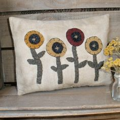 DIY Wool Applique Primitive Flower Garden Pillow. $3.50. http://www.patternmart.com/pattern/15826/Primitive+Flower+Garden+PIllow