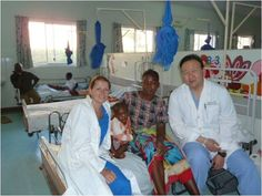 """This is Marike, Pemphiro, and me, in the """"family portrait"""".     I really felt that I was honored to be allowed to operate on these patients.  Despite the language and culture barrier, I think that all of the families could tell that we took their pain and surgical problems seriously, and that we would fix them to the highest standards possible."""