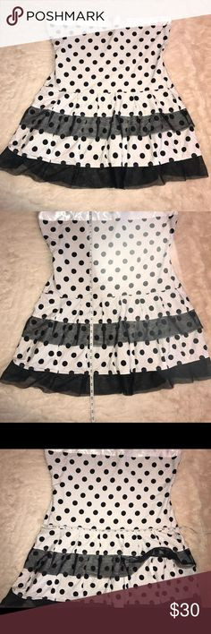 Plus size white dot strapless dress pinup punk Worn once white/offwhite black dot strapless dress plus size. There is no tag stating the size and the brand of tag is hanging by one thread,so please see measurements as shown in pics. Back zipper enclosure attached slip dress underneath . Front has cute tulle detail .All items come from smoke free home. 🐺Husky friendly environment. All items are kept in plastic containers, but shed happens 😊 Dresses Strapless