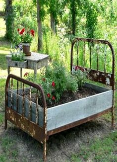 Raised garden beds using recycled materials