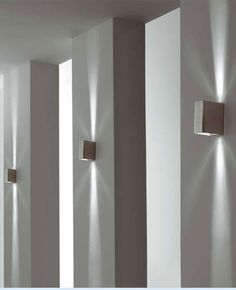 Repetition of white sections with indirect lighting, Sunrise wall sconces by Morosini _