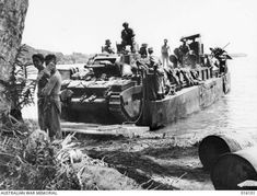 Matilda tanks landing at Finschhafen, November 1943. Nine tanks from the 1st Tank Battalion were landed and would see action along the road to Sattelberg. AWM 016101.