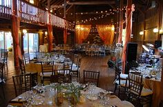 Reception in a barn, with thousands of white lights.