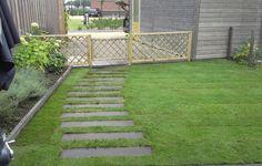 Leuk om stenen in gras te verwerken, tuinpad, makkelijk grasmaaien