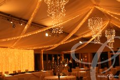 Braxted Park, Essex.  Fairy light drapes and chandeliers for marquee wedding.