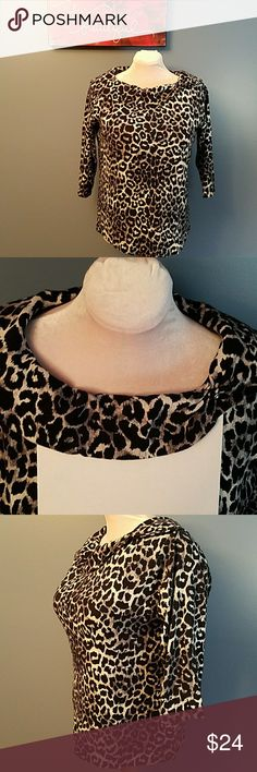 RAFAELLA Black & white snow leopard print top Show off your animal side & your curves with this gorgeous black and white snow leopard, 3/4 sleeve top! It has a folded, wide collar, with a pretty 2 button detail in the left shoulder. The 2nd photo is my attempt to show the collar. The photos don't do this fabulous  shirt justice as it is so much prettier in person! -Size 1X -In excellent condition -100% cotton -Approximate measurements: Armpit to armpit = 25in; Shoulder to hem = 26in…
