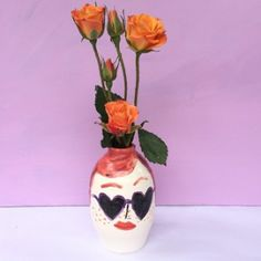 Heart sunglasses face vase