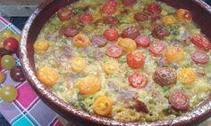Arroz al horno con costilla, lomo y tomates cherry