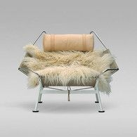 """""""Tribal"""" For the raw in mind and cozy at heart. An elegant haired chair.    False Arms / Armes Fausses $5000+"""