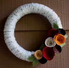 DIY Fall Wreath tutorial - Simple and clever. Wonder is I could scotch guard it so it can be outside in the rainy weather without getting gross.