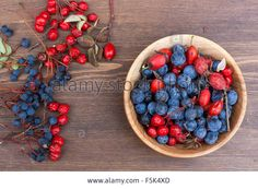 Download this stock image: Autumn still life with autumn berry on wooden background, closeup - F5K4XD from Alamy's library of millions of high resolution stock photos, illustrations and vectors.