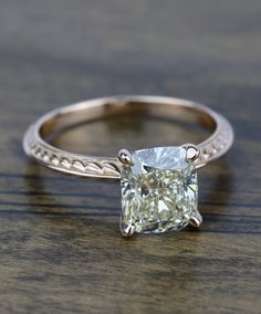 An absolutely stunning Antique Knife-Edge Cushion Diamond Engagement Ring!