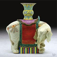 CHINA QING DYNASTY - A RARE FAMILLE-ROSE PORCELAIN MODEL OF AN ELEPHANT