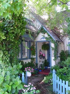 Gorgeous cottage garden walk to the front door. Love the painted little fence out front. tumblr photo only