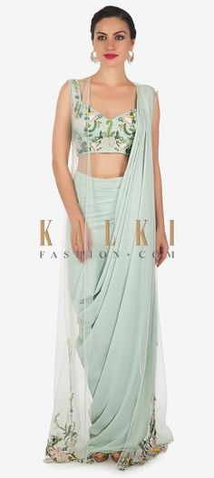 This powder blue drape suit has it all; it is sensual, elegant and classy. The drape of the free flowing georgette fabric adds grace. Saree Draping Styles, Drape Sarees, Saree Styles, Dress Neck Designs, Saree Blouse Designs, Sharara Designs, Indian Designer Outfits, Designer Dresses, Indian Dresses