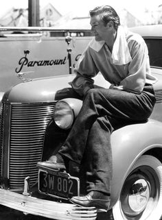 wehadfacesthen:  Gary Cooper sits on the fender of his De Soto on the Paramount lot, 1937 SOURCE: avasgal