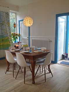 Scandinavian kitchen with Eames chairs, also loving the curtains pattern.