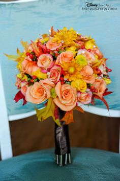 This fabulous fall bouquet is the perfect compliment to a crisp weather soiree #Disney #wedding #fall #bouquet
