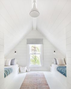 Fresh white kids room with vintage textiles in converted attic space. Amber Interiors.