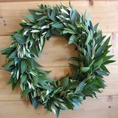 simple and beautiful laurel wreath - with round tables use this shape with a candelabra and taper candles set inside...tea lights around the outside???