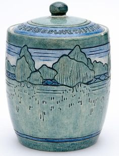 NEWCOMB COLLEGE Exceptional and early biscuit jar and cover, carved by Lucia Jordan, 1907