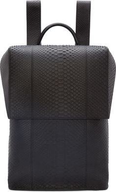 Balenciaga structured Black Python leather Phileas Backpack. 18x12x6 in. Retail price was $3350 at Neiman Marcus. 30 August 2016 for sale on Tradesy for $2990 (NWT). 30 August 2016 for sale on eBay for $2500 (NWT).