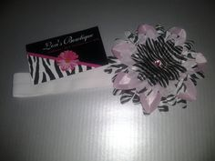 Baby Pink & Zebra Print Flower headband w/ a double sided ultra soft elastic band. $7.00, via Etsy.